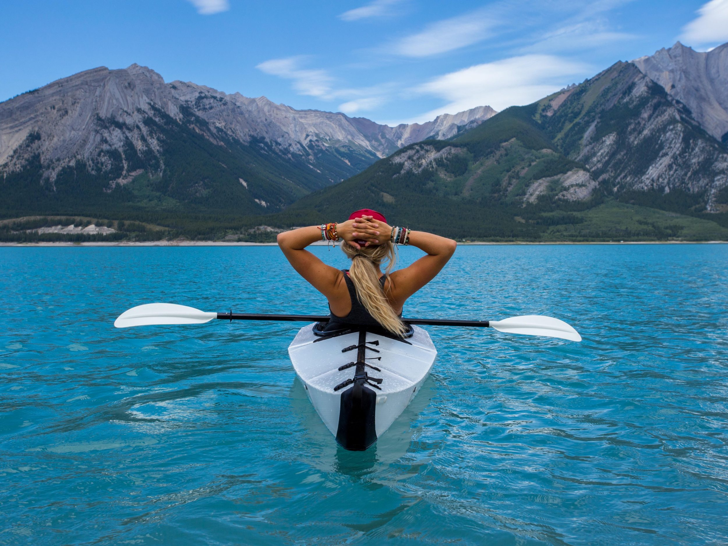 Woman in canoe on lake - image from Shopify store