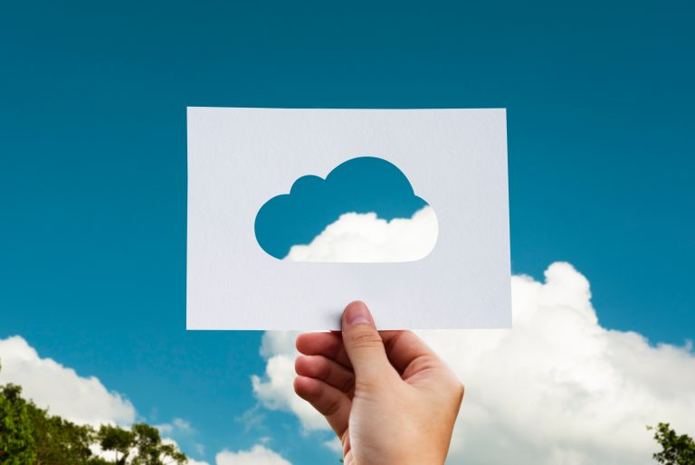 Cloud seen through cut-out in card - image on our careers page