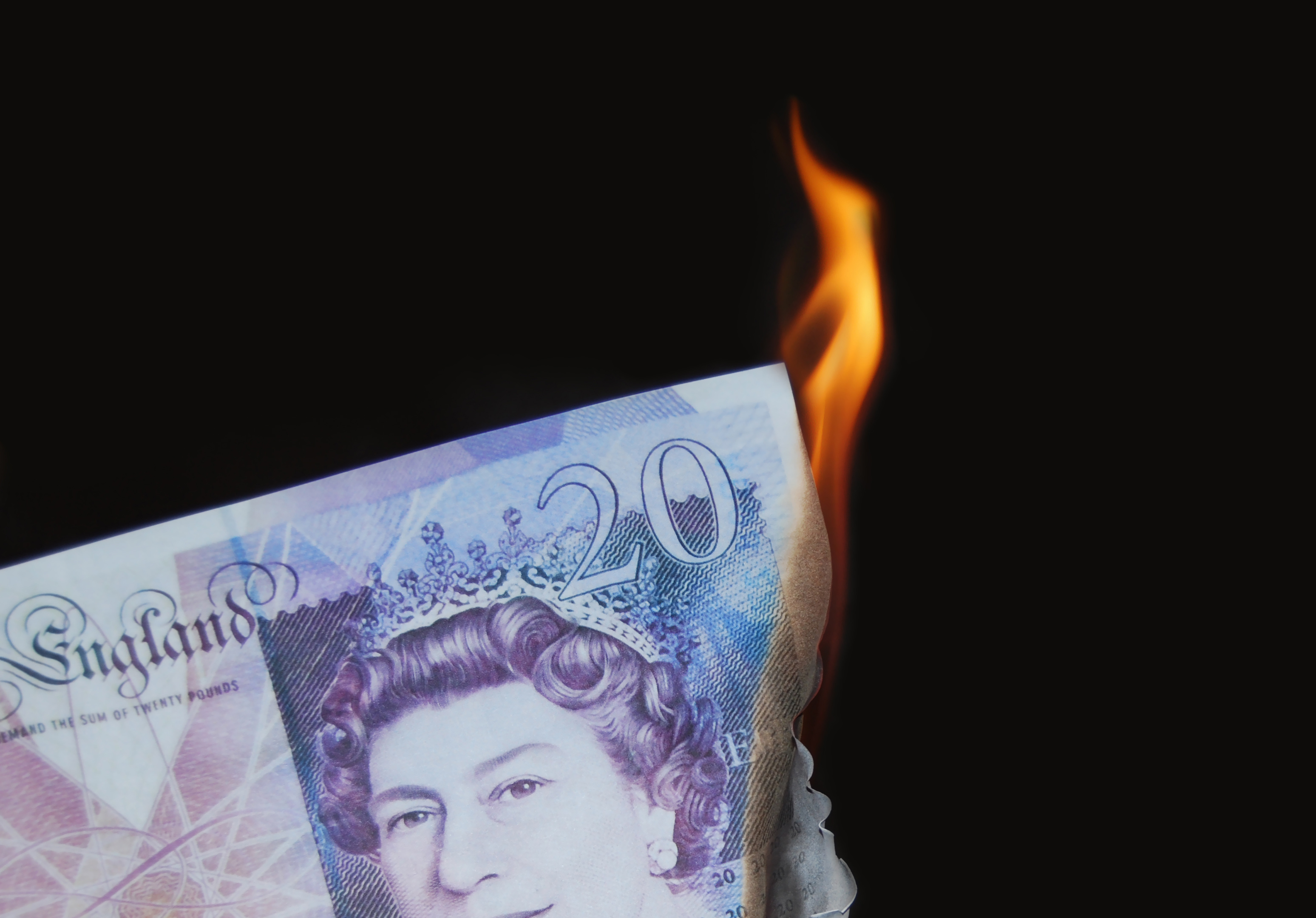 Bank note on fire representing time and money wasted by using bad data